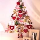 alternative holiday trees - wall Christmas tree made with ornaments via Atticmag