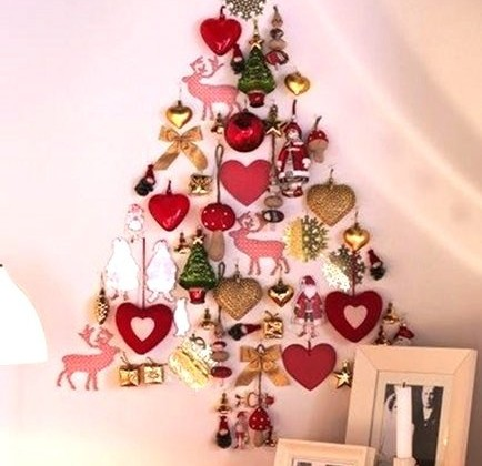 alternative holiday trees - wall Christmas tree made with ornaments via Atticmag