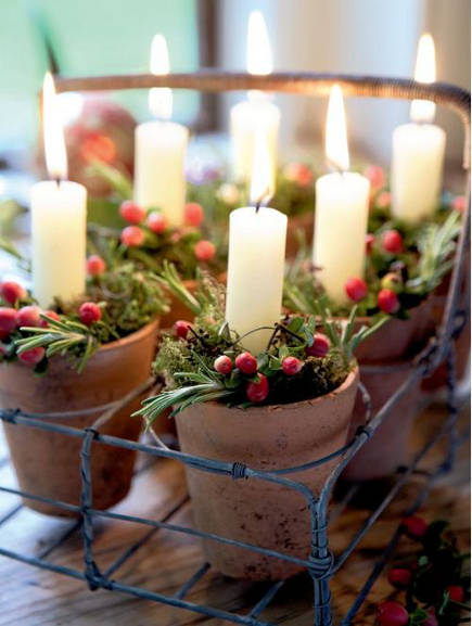 Christmas berry decor - red berries with rosemary sprigs and moss in candle planter pots - chic deco via atticmag
