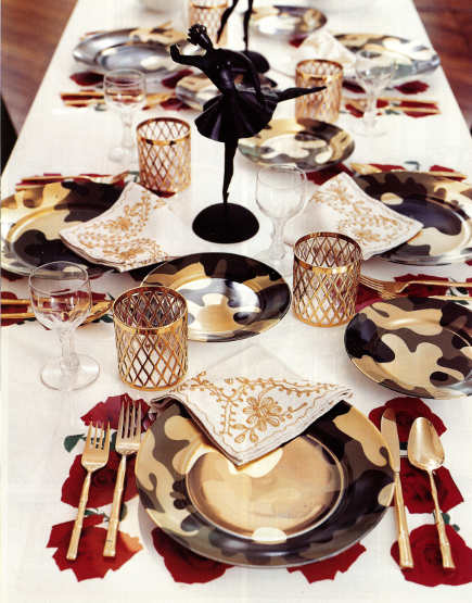 holiday table - gold and roses them with modern plates - town & country via atticmag