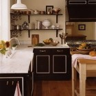 black kitchen cabinets - with white accents in a kitchen with block open shelving- Fairfax & Sammons Architecture via Atticmag