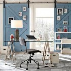 double interior barn doors, painted blue and used for display - West Elm via Atticmag