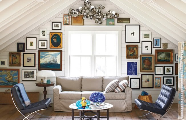 picture wall - studio living room with pictures hung on a triangular wall - Elle Decor via atticmag