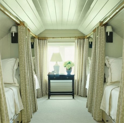 attic rooms - guest room with 4 sleeper car style draped beds - highstreet market via atticmag
