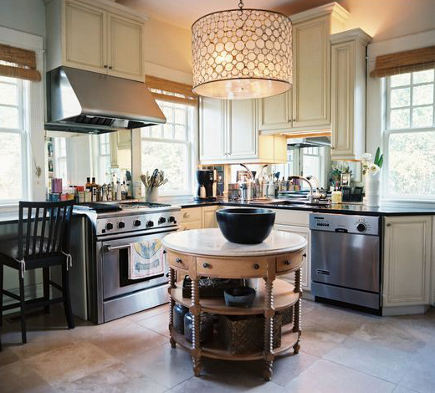 kitchen with antique table in the round used as an island - lonny via atticmag