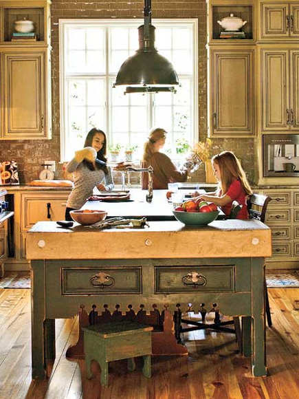 kitchen with green-painted vintage French butcher block kitchen island variation with crenolated apron - southern living via atticmag