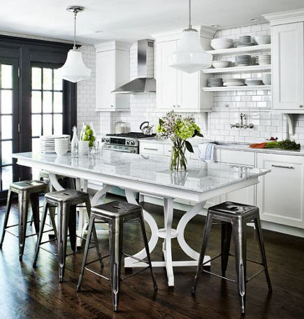 kitchen island variation table made from repurposed dining room table bases - house and home via atticmag