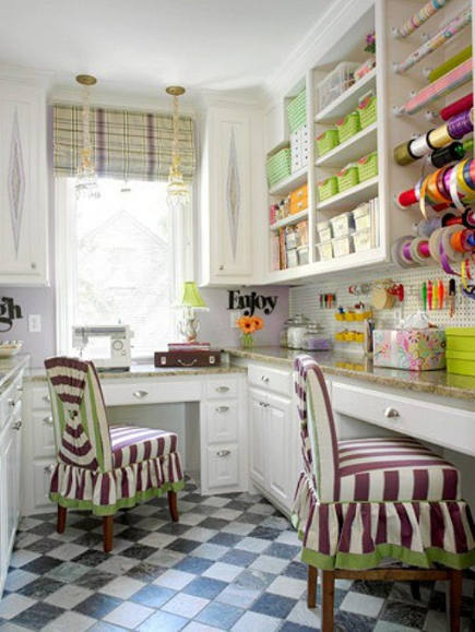 crafts room ideas - sewing and crafts room with built in cabinets, a big window and counters at two different heights - bh&g via atticmag