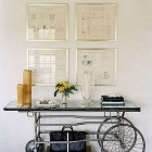 vintage medical gurney table repurposed into hallway console table - harpers bazaar via atticmag