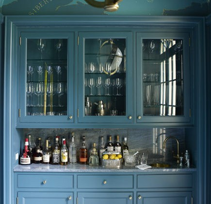 Chinese blue cabinets in a butler's pantry and bar designed by Miles Redd via atticmag
