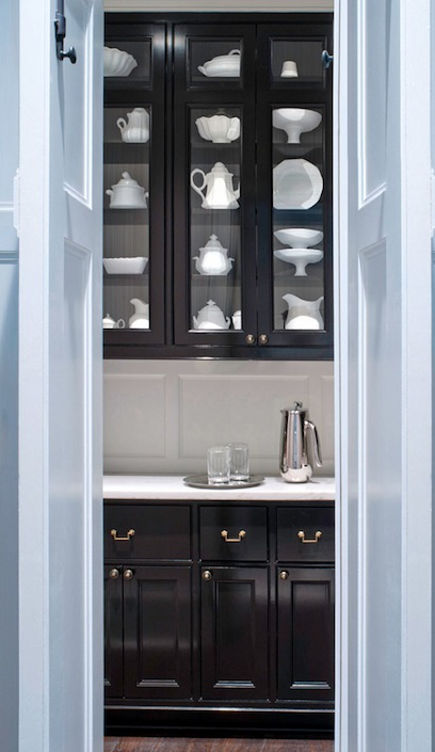 Glossy black butler's pantry with white marble counters and gray inside glass-front upper cabinets - donaldlococoarchitects via atticmag