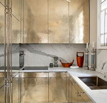 heavy metal cabinetry - hammered silver cabinets in a French kitchen - elle deco via atticmag