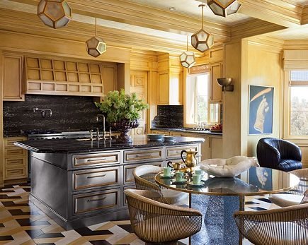 heavy metal cabinetry - stainless steel with brass trim kitchen island by Kelly Wearstler - architectural digest via atticmag