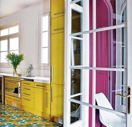 yellow kitchen cabinets and colorful geometric cement floor tiles - Casa Vogue Brazil via Atticmag