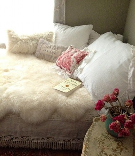 shearling area rug used on a bed by Laura Venosa via Atticmag