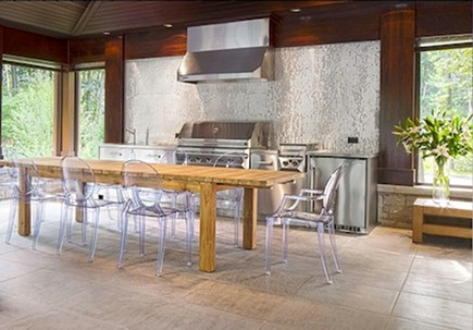 silver tile mosaic tile backsplash in an outdoor kitchen by Gestion Rene Desjardins via atticmag
