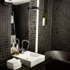 modern black bathroom with 1-inch mosaic tiles on walls and floor - Jimmy Schonning via Atticmag
