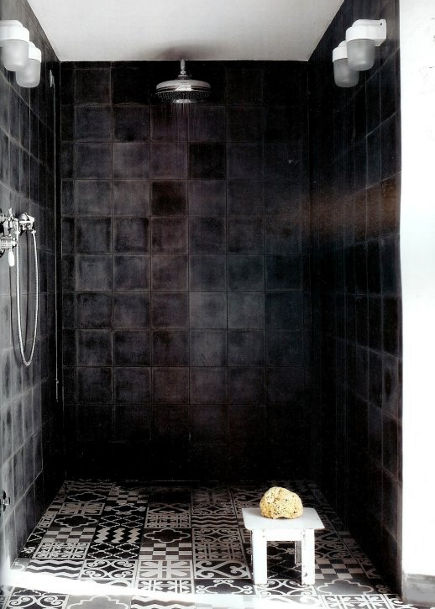 modern black bathroom with solid black and patterned Moroccan tile shower by Paola Navone - dwell via atticmag