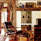 antique window shutters made into tv niche cabinet doors - country home via atticmag