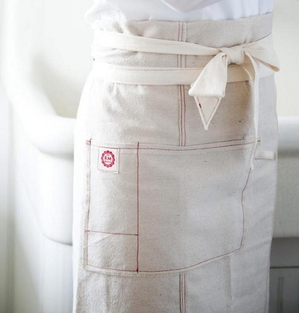 organic kitchen linens - cotton French style apron by Raw Materials Design via Atticmag