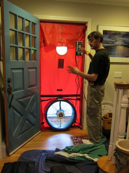 LED light bulbs - Energy Conservation Specialists' Bill Mc Knight doing our home energy audit -Atticmag