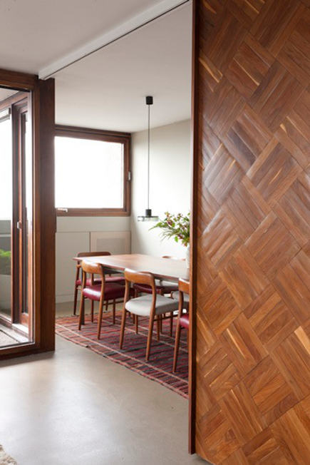 reclaimed parquet barn doors for a dining room by Retrouvius via atticmag