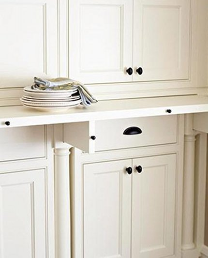 kitchen cabinet ideas - hidden pull out counter in the pantry - midwest living via atticmag