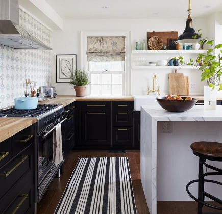 kitchen pattern - black and white kitchen with gray pattern backsplash and black and white striped rug - house and home via atticmag