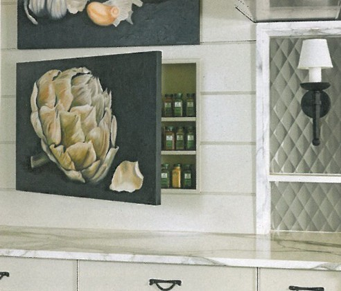 spice cabinet concealed by a hand painted canvas door - Pursley Dixon Architecture via atticmag