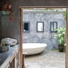 outdoor soaking tub - egg shape outdoor bathtub in a house by Valentina Audrito - homelife via atticmag