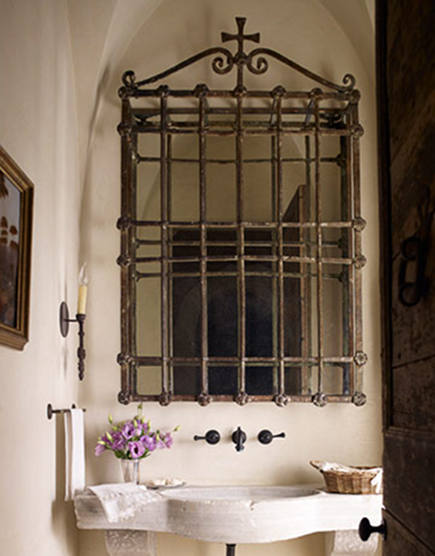 iron mirrors - repurposed ornamental iron window grilles into bathroom mirror by Eleanor Cummings Interior Design - house beautiful via atticmag