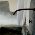 industrial style sink faucets - traditional Moroccan copper bathroom sink spigot and handles - nytimes via atticmag