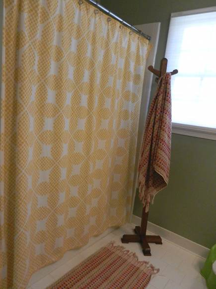 child's bathroom renovation - childrens bathroom remodel with coat rack for towels via Atticmag