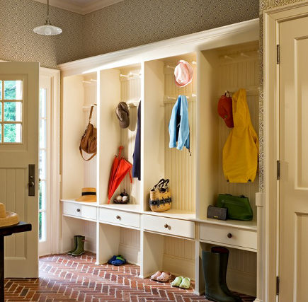 mudroom storage - Mudroom entry with drawers, hanging bays and herringbone brick floor. forbes.com via Atticmag