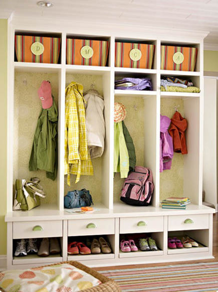 mudroom storage - hanging bays with wallpaper, drawers, shelves and shoe storage. bh&g via Atticmag