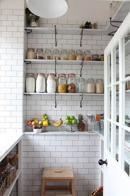 kitchen pantry ideas - white subway tile pantry with marble shelves - Remodelista via Atticmag