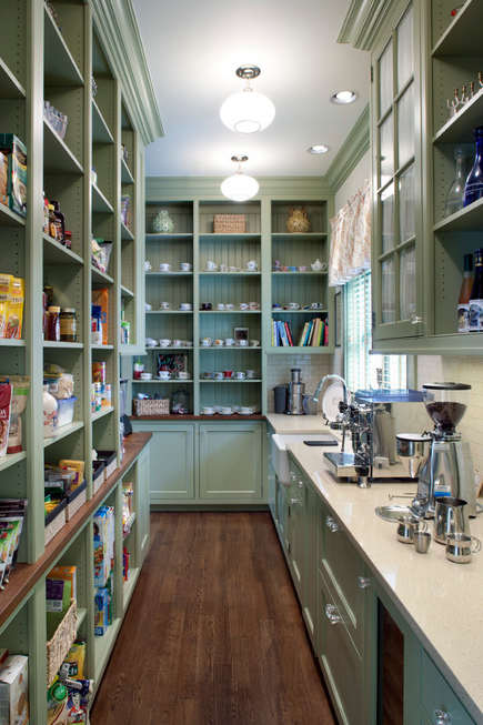 kitchen pantry ideas - green kitchen with floor to ceiling pantry aisle - Ambiance Ashville via Atticmag