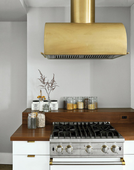 natural brass fixtures - brush brass Rangecraft kitchen vent hood - Dwell via Atticmag