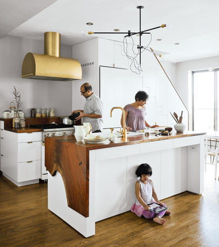 natural brass fixtures - contemporary white kitchen with custom brass Rangecraft vent hood - Dwell via Atticmag
