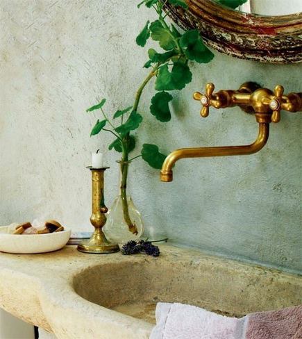 natural brass fixtures - wall mounted powder room sink fixture in brass tone - decoholic via atticmag
