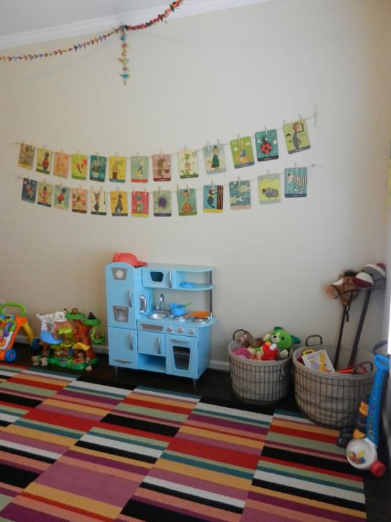 colorful playroom - with FLOR carpet tiles and KidKraft vintage blue kitchen via Atticmag