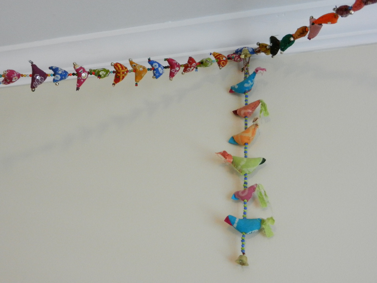 colorful playroom - fabric bird hanger collection via Atticmag