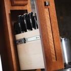 custom kitchen cabinet ideas - pull out knife storage - Dura Supreme Cabinetry via Atticmag