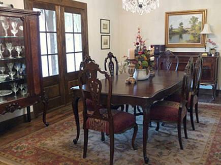 vintage painted shutters - stone cottage dining room Tulsa architect Jack Arnold - atticmag