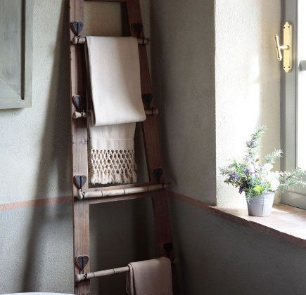 custom towel racks - ladder shaped country towel rack in an Italian villa - rosesandrust via atticmag
