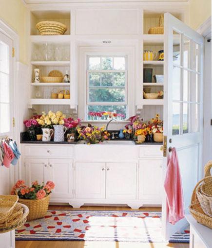 mudroom sinks - Cottage style flower cutting sink mudroom - House Beautiful via Atticmag