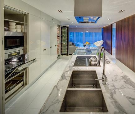 minimalist galley kitchen - Miele award winning kitchen - Architizer via Atticmag