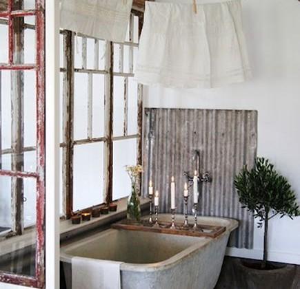 rustic bathroom ideas - tub alcove with corrugated tin splash guard