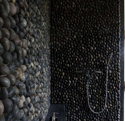 black bathroom tile - volcanic stone shower - Architizer via Atticmag