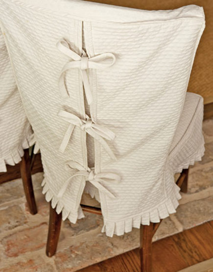 dining chair slipcovers - textured cotton slipcover with bow-tie closing - country living via Atticmag